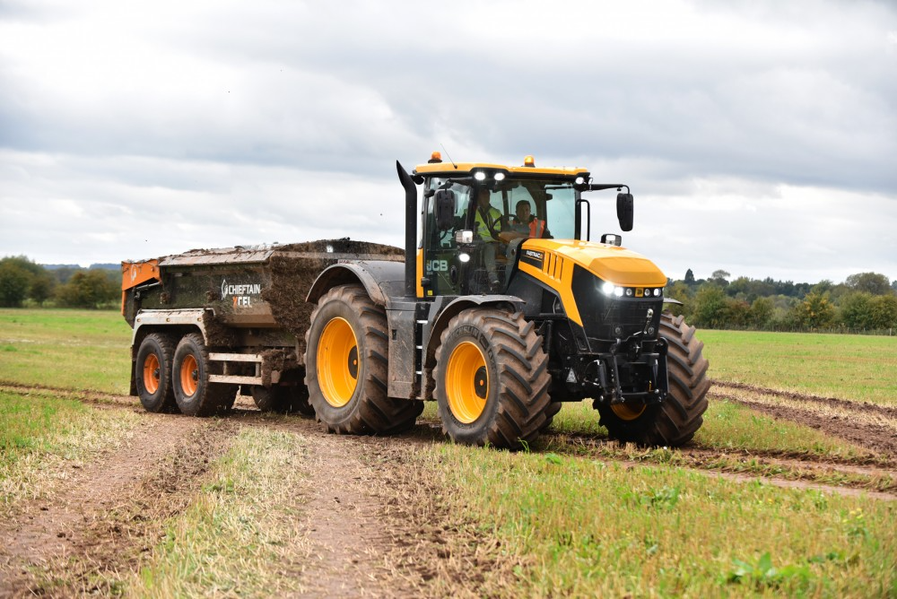 Chieftain Dump Trailer hitched on Tractor in field