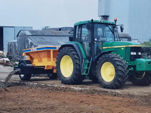 Spreader Trailer hitched to tractor