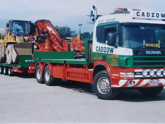 Lorry with trailer and digger
